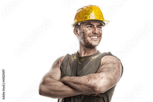 Fotografia  portrait of dirty worker with helmet crossed arms