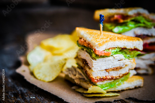 Poster Snack Club sandwich on rustic wooden background