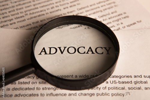 document with the title of advocacy under a magnifying glass Canvas Print