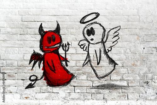 Fotografía Ángel y demonio de lucha; dibujo dibujos en la pared de ladrillo blanco