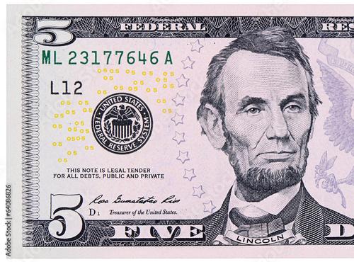 Fotografia  Five dollars isolated on white background