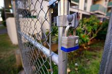 Padlock On A Fence