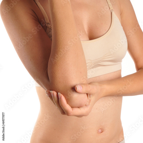 Fotografía  Female holding hand to spot of elbow pain.