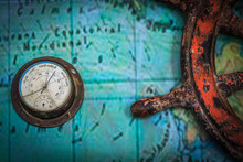 Old Vintage Barometer Together With Old Ship's Wheel Attached On A Wall