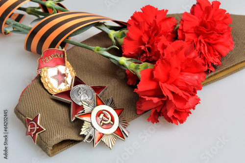 Poster  Military cap, red flowers, Saint George ribbon, orders of Great