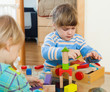 siblings together playing with blocks
