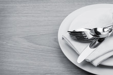 Silverware Or Flatware Set Of Fork, Spoons And Knife On Plate