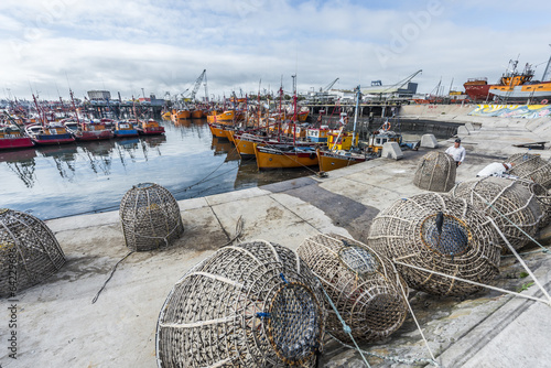 Photo  Orange fishing boats in Mar del Plata, Argentina
