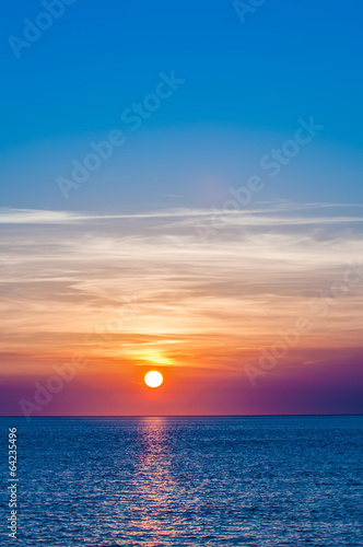 Beach sunset at sea with multiple color prizm