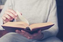 Man Flipping Through Big Book