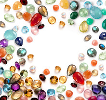 Colorful Gemstones On White Background. Mix Of Real Stones.