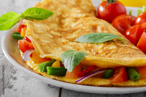 Spoed Foto op Canvas Gebakken Eieren omelet with vegetables and cherry tomatoes