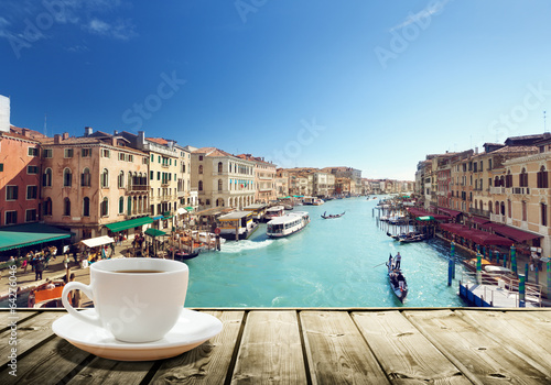 Canvas Prints Pool coffee on table and Venice in sunset time, Italy
