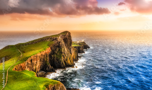 Photo Stands Lighthouse Colorful ocean coast sunset at Neist point lighthouse, Scotland