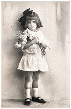 Antique Photo Portrait Of Little Girl With Flowers. Mother's Day