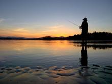 Man Fishing At Sunset In Bate Mans Bay