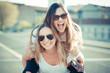 Leinwanddruck Bild - two beautiful young women having fun