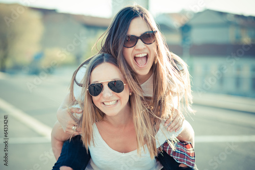 Fotografie, Obraz  two beautiful young women having fun