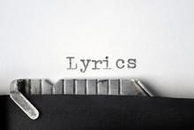 """""""Lyrics"""" Written On An Old Typewriter. Closeup."""