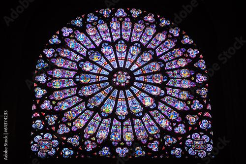 Fotografia  Stained glass window inside Notre Dame de Paris