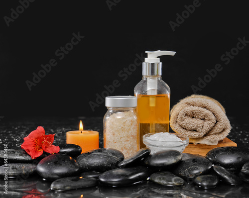 Poster Spa Still life with red flower, massage oil, candle ,stones