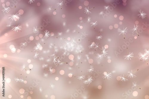 Digitally generated dandelion seeds on pink background
