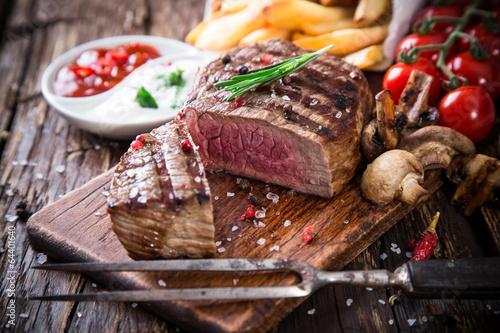 Beef steak on wooden table Wallpaper Mural
