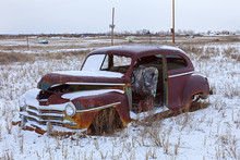 Old Abandoned Car Covered With...