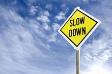 Slow Down Yellow Road Sign Aga...