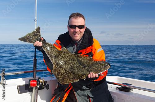 Slika na platnu Happy angler with halibut fish