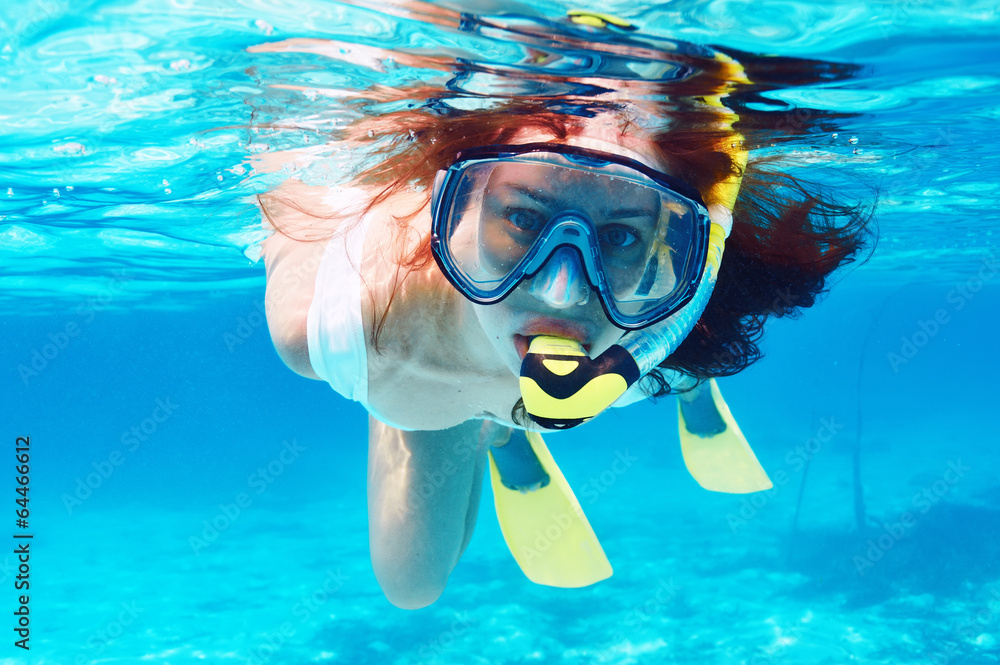 Fototapeta Woman with mask snorkeling