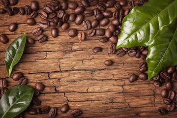 Fototapeta Coffee beans and green leaves