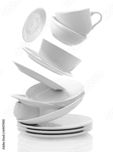 Fotografia  Clean empty plates and cups isolated on white