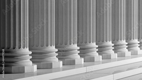 White ancient marble pillars in a row Canvas Print