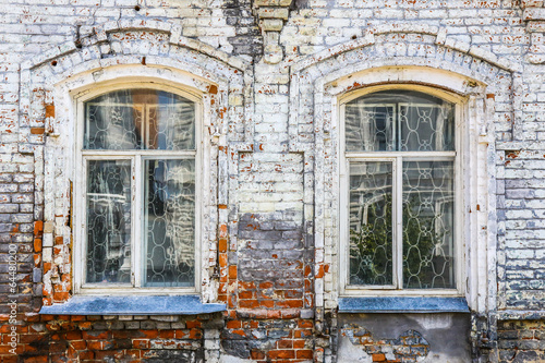 wall of old brick house with windows