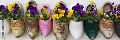 Dutch wooden clogs with flowers Canvas Print