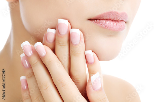 Staande foto Manicure Part of female face and hands, white background, copyspace