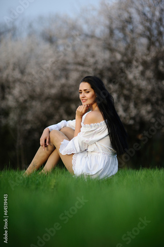 girl in white dress on the grass Canvas Print