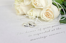 White Roses And Rings On Weddi...