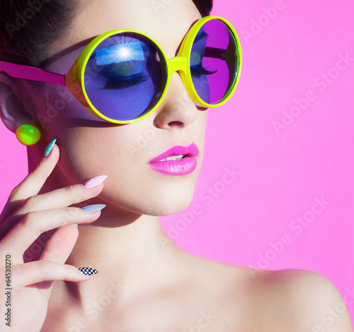 Colorful summer portrait attractive young woman with sunglasses Wall mural