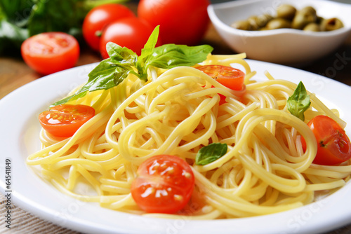 Fotografie, Obraz  Delicious spaghetti with tomatoes on plate on table close-up