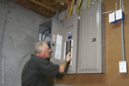 man standing next to fuse box in a basement buy this stock photo rh stock adobe com