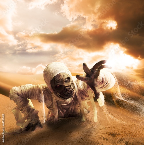 Canvas Print Scary mummy in a desert at sunset with copy space