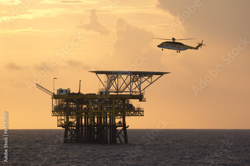 Photo Stands Helicopter A helicopter transports roughnecks to a rig