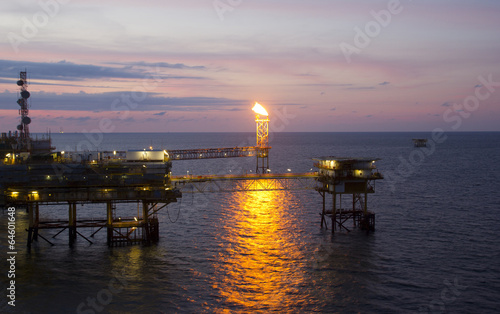 Staande foto Industrial geb. Gas or flare burn on offshore platform