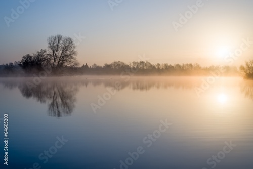 Foto op Aluminium Meer / Vijver Perfect sunrise over lake with suburban area in the background