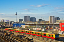 Cityscape With Railroads In Be...
