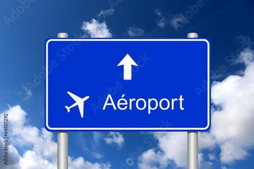 Photo  Panneau direction aéroport sur fond ciel d'été