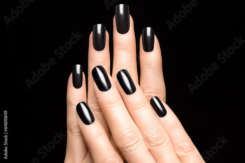 Photo  Woman hands with black nails