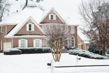 Brick Home And Lawn In Snow